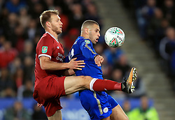 Liverpool's Ragnar Klavan (left) and Leicester City's Islam Slimani battle for the ball during the Carabao Cup, third round match at the King Power Stadium, Leicester.