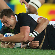 Israel Dagg, New Zealand, is tackled during the New Zealand V France Final at the IRB Rugby World Cup tournament, Eden Park, Auckland, New Zealand. 23rd October 2011. Photo Tim Clayton...