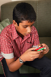 Portrait of boy playing on a game,