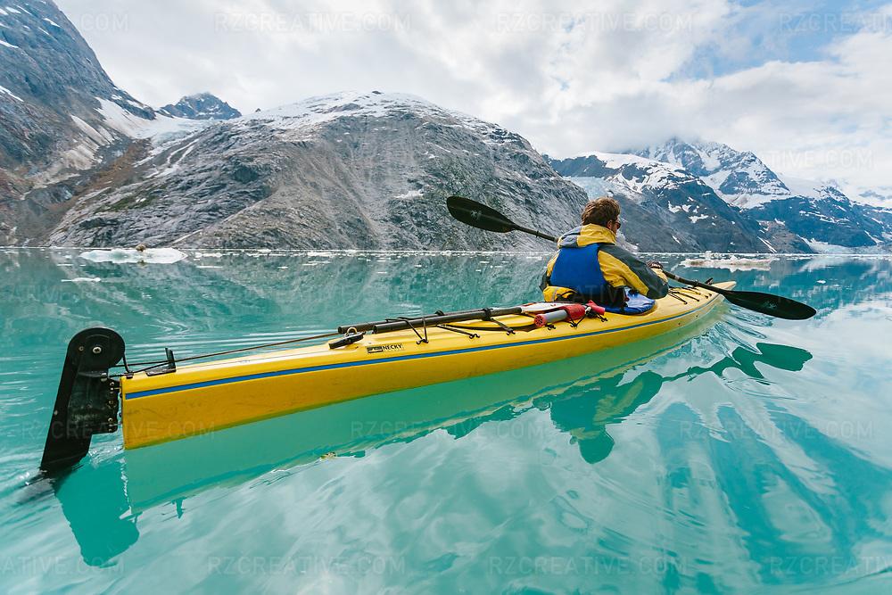 A kayaker paddling in Johns Hopkins Inlet, part of southeast Alaska's Glacier Bay National Park.