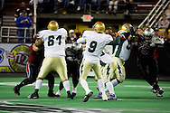 4/12/2007 - Dustin Almond (9) drops back for a pass against the Alaska Wild, leading the Frisco Thunder to a 46-33 in the first professional football game in Alaska.