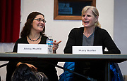 Anna Moffit and Mary Burke share a laugh before the South Side Madison Madison School Board public forum hosted by Mount Zion Baptist Church in Madison, Wisconsin, Tuesday, March 6, 2018.