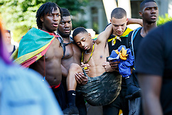 © Licensed to London News Pictures. 29/08/2016. London, UK. A drunk men helped by his friends on the second day of Notting Hill Carnival in west London, Monday 29 August 2016. Photo credit: Tolga Akmen/LNP