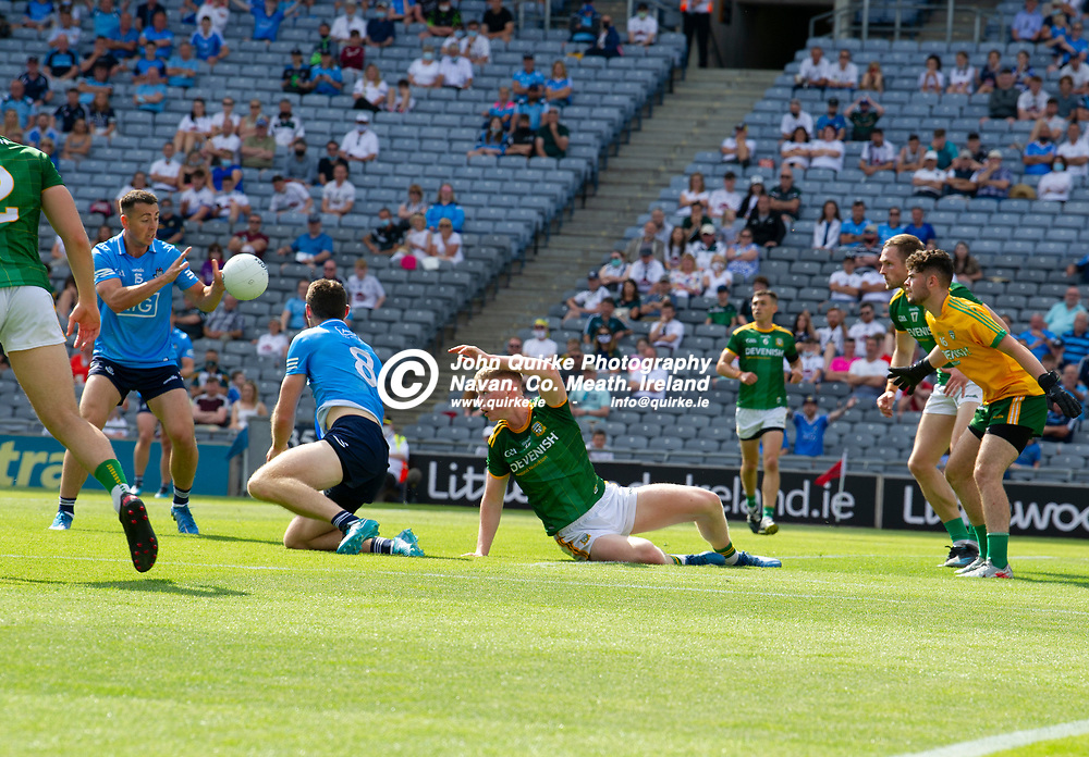 18-07-21. Meath v Dublin - Leinster SFC Semi-Final at Croke Park.<br /> Brian Fenton in spite of being grounded gets a pass to Cormac Costello.<br /> Photo: John Quirke / www.quirke.ie<br /> ©John Quirke Photography, 16 Proudstown Road, Navan. Co. Meath. (info@quirke.ie / 046-9028461 / 087-2579454).