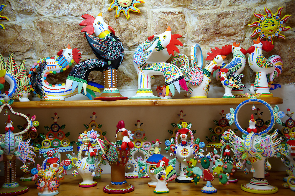 Trulli whistle shop La Botega die Finchietti, interior. Ornate traditional folk art whistles of the region. Alberobello, Puglia, Italy.  Pictures, photos, images & fotos. .<br /> <br /> Visit our ITALY HISTORIC PLACES PHOTO COLLECTION for more   photos of Italy to download or buy as prints https://funkystock.photoshelter.com/gallery-collection/2b-Pictures-Images-of-Italy-Photos-of-Italian-Historic-Landmark-Sites/C0000qxA2zGFjd_k