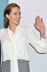 Image ©Licensed to i-Images Picture Agency. 11/06/2014.<br /> <br /> Angelina Jolie tours the main hall during day 2 of the Global Summit to End Sexual Violence in Conflict at The ExCel, London, UK.<br /> <br /> Wednesday 11th June 2014<br /> Picture by Ben Stevens / i-Images