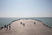 People congregating on Hastings Pier on the 20th April 2019 in Hastings in the United Kingdom.