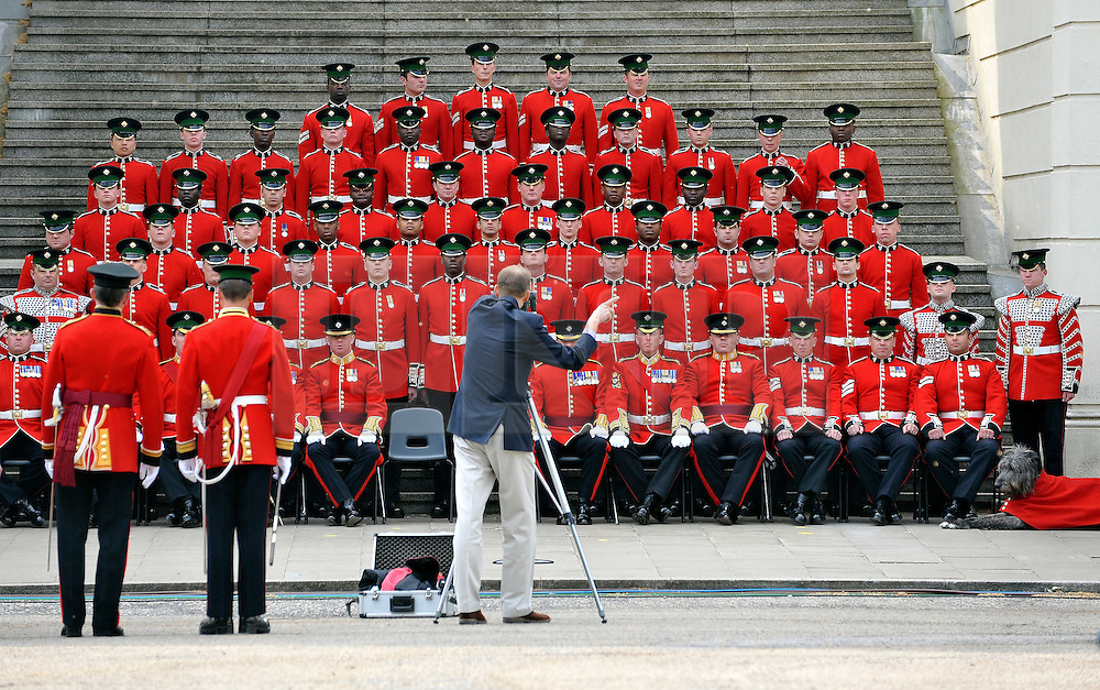 © under license to London News Pictures. LONDON, UK  28/04/2011. The Royal Wedding of HRH Prince William to Kate Middleton. The Irish Guards have a regimental photograph taken the day before they go on duty for the Royal Wedding (28/04/11) Photo credit should read Stephen Simpson/LNP. Please see special instructions.
