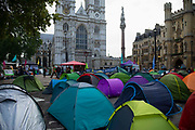Climate change protesters tents in the road at Westminster Abbey on 8th October, 2019 in London, Untited Kingdom. Extinction Rebellion plan to occupy 12 sites situated around key Government locations around Westminster for two weeks to protest against climate change.