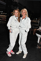 Left to right, GRAINNE STEVENSON and TAMARA BECKWITH at a Girl Karting - a charity Go-Karting evening in aid of Too Many Women held at The Raceway, 3 Herringham Road, London SE7 on 12th September 2012.