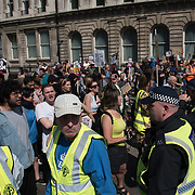 "Anti-Fascist gathered at Whitehall Oppose Tommy Robinson & the ""Democratic"" Football Lads Alliance, demonstration and a few British Nationalists cross the anti-fascist line and been chased away  on 6 May 2018, London, UK"