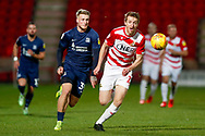 Southend United forward Stephen Humphrys (39) challenges Doncaster Rovers defender Tom Anderson (12)  during the EFL Sky Bet League 1 match between Doncaster Rovers and Southend United at the Keepmoat Stadium, Doncaster, England on 12 February 2019.