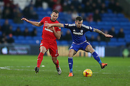 Joe Ralls of Cardiff city ® holds off Jordan Rhodes of Blackburn Rovers.Skybet football league championship match, Cardiff city v Blackburn Rovers at the Cardiff city stadium in Cardiff, South Wales on Saturday 2nd Jan 2016.<br /> pic by Andrew Orchard, Andrew Orchard sports photography.