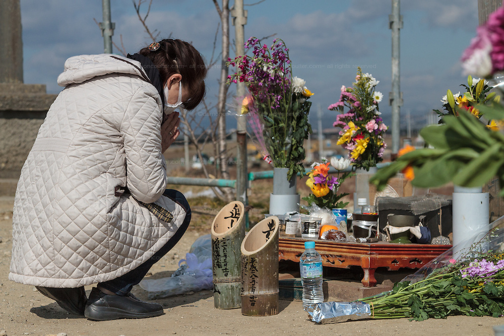 People come to leave flowers and pray who  at a shrine on Hiyori yama  or Weather Hill to remember victims of the tsunami at  Miyagi, Japan. Friday March 11th 2016. 2016 marks the fifth anniversary of the Great East Japan earthquake. This magnitude 9 quake caused a tsunami that flattened large parts of the Tohoku coast killing around 18,000 people and triggering a nuclear disaster at Fukushima Daichi Power Station.