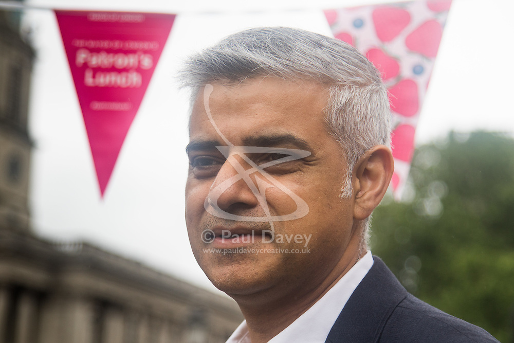 Trafalgar Square, London, June 12th 2016. Rain greets Londoners and visitors to the capital's Trafalgar Square as the Mayor hosts a Patron's Lunch in celebration of The Queen's 90th birthday. PICTURED: Mayor of London Sadiq Khan speaks to the press.