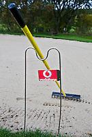 WESTERBURG , DUITSLAND - reclame van Vodafone op de standaard voor een hark in een bunker, Golf Club Wiesensee bij Lindner Hotel & Sporting Club Wiesensee in Westerburg (Westerwald). COPYRIGHT KOEN SUYK