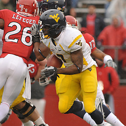 Dec 5, 2009; Piscataway, NJ, USA; West Virginia running back Noel Devine (7) runs for a touchdown during first half NCAA Big East college football action between Rutgers and West Virginia at Rutgers Stadium.