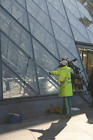 Cleaning the glass pyramid at the Louvre, Paris, France<br />