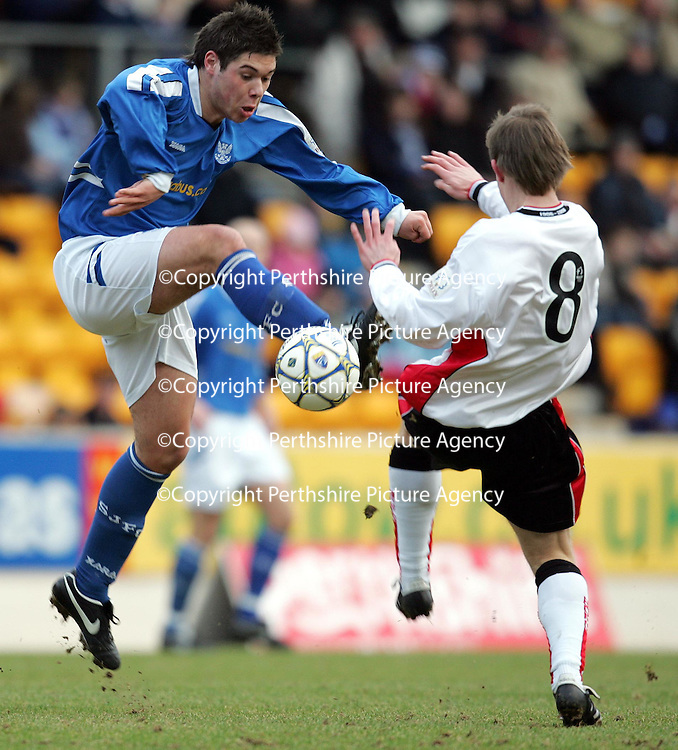 St Johnstone v Brechin...28.01.06.<br />Saints new boy Jamie Winter wins the battle with Brechin trialist Kevin Nicol<br />Picture by Graeme Hart.<br />Copyright Perthshire Picture Agency<br />Tel: 01738 623350  Mobile: 07990 594431