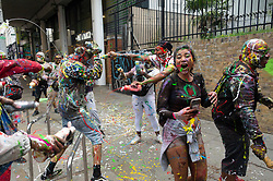 © Licensed to London News Pictures. 26/08/2018. London, UK. Revellers enjoy Jouvert, a paint fight that officially marks the start of the Notting Hill carnival. The two day event is the second largest street festival in the world after the Rio Carnival in Brazil, attracting over 1 million people to the streets of West London. Photo credit: Ray Tang/LNP