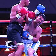 Jose Beitia (R) punches Eliecer Tenoria during their WBO boxing match at the Hotel El Panama Convention Center on Wednesday, October 31, 2018 in Panama City, Panama. (Alex Menendez via AP)