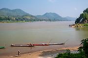 Image of fishermen preparing for the day along the Mekong River, Luang Prabang, Laos.
