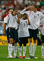 Photo: Glyn Thomas.<br />England v Portugal. Quarter Finals, FIFA World Cup 2006. 01/07/2006.<br /> England's (L-R) Rio Ferdinand, Ashley Cole and Peter Crouch are dejected as their team loses on penalties.