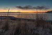 Just before sunrise at Lake DeSmet, fog was lifting off of the water. With the temperature at 5°F, the fog left behind thick rime ice along the shore.