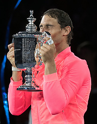 September 10, 2017 - Flushing Meadows, New York, U.S - Rafael Nadal kisses his Championship trophy on Day Fourteen of the Men's 2017 US Open Final played against Kevin Anderson at the USTA Billie Jean King National Tennis Center on Sunday September 10, 2017 in the Flushing neighborhood of the Queens borough of New York City. Nadal defeats Anderson, 6-3, 6-3, 6-4. JAVIER ROJAS/PI (Credit Image: © Prensa Internacional via ZUMA Wire)