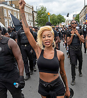 Imarn Ayton  leading the Brixton Blackout walk from Clapham Common to  Windrush Square  Brixton to joing the  Afrikan Emancipation Day celebrations in windrush sq photo by mark anton smith
