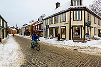 Man bicycling through Bakklandet (Old Town), Trondheim, Norway.