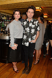PIXIE GELDOF and NICK GRIMSHAW at the Kiehl's Icons VIP Dinner held at the Balthazar Dining Room, Wellington Street, London on 26th March 2014.