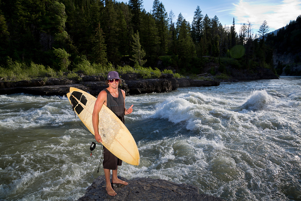 Surfer Dustin portrait on the Hoback section of the South Fork of the Snake River surfs a rapid called Lunch Counter on an early June afternoon in Wyoming. Licensing and Open Edition Prints