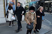 Woman with an animal print fur coat and hat on Bond Street in London, England, United Kingdom. (photo by Mike Kemp/In Pictures via Getty Images)