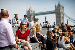 © Licensed to London News Pictures. 09/05/2016. London, UK. City workers enjoy sunshine and warm weather on their lunch breaks near City Hall in London on Monday, 9 May 2016. Photo credit: Tolga Akmen/LNP