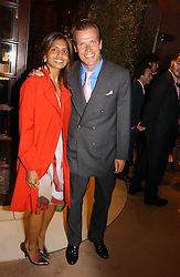 DIVIA LALVANI and JOEL CADBURY at a party to celebrate 100 years of Chinese Cinema hosted by Shangri-la Hotels and Tartan Films at Asprey, New Bond Street, London on 25th April 2006.<br /><br />NON EXCLUSIVE - WORLD RIGHTS