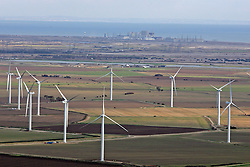 Image ©Licensed to i-Images Picture Agency. Aerial views. United Kingdom.<br /> THE WIND FARM ON THE ROMNEY MARSH AND IN THE BACKGROUND IS THE DUNGENESS NUCLEAR POWER STATION. Picture by i-Images