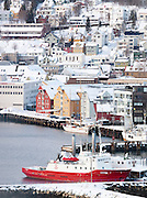The dock in the city of Tromso, still with many wood built houses, in northern Norway