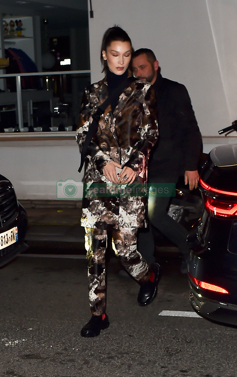 Bella Hadid & Gigi Hadid make there way out to a dinner party in Paris. 04 Mar 2019 Pictured: Bella Hadid , Gigi Hadid. Photo credit: Neil Warner/MEGA TheMegaAgency.com +1 888 505 6342
