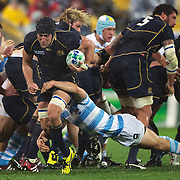 Kelly Brown, Scotland, is tackled by Nicolas Vergallo, Argentina, during the Argentina V Scotland, Pool B match at the IRB Rugby World Cup tournament. Wellington Regional Stadium, Wellington, New Zealand, 25th September 2011. Photo Tim Clayton...