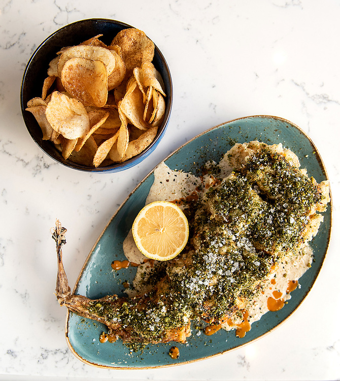 Photo by Mara Lavitt<br /> January 22, 2019<br /> New Haven, CT<br /> <br /> Olmo restaurant (also Olmo Kitchen). The fish 'n chips: monkfish, pickled mayo, lemon, kimchi hot sauce, house chips.