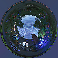 Backyard Late Summer Nighttime Sky Over New Jersey. Inverse Little Planet (Tunnel View) 360 degree Panorama. Composite of 360 (DNG) images taken with a Ricoh Theta Z1 360 camera (ISO 400, 2.6 mm, f/2.1, 60 sec). DNG images processed with Capture One Pro, converted to 360 Equirectangular with PTGUI, Star Trail composite generated with PhotoShop CC (scripts, statistics, maximum). Tunnel view created with PhotoShop CC  (image size 1:1, filter, distort, polar coordinates).