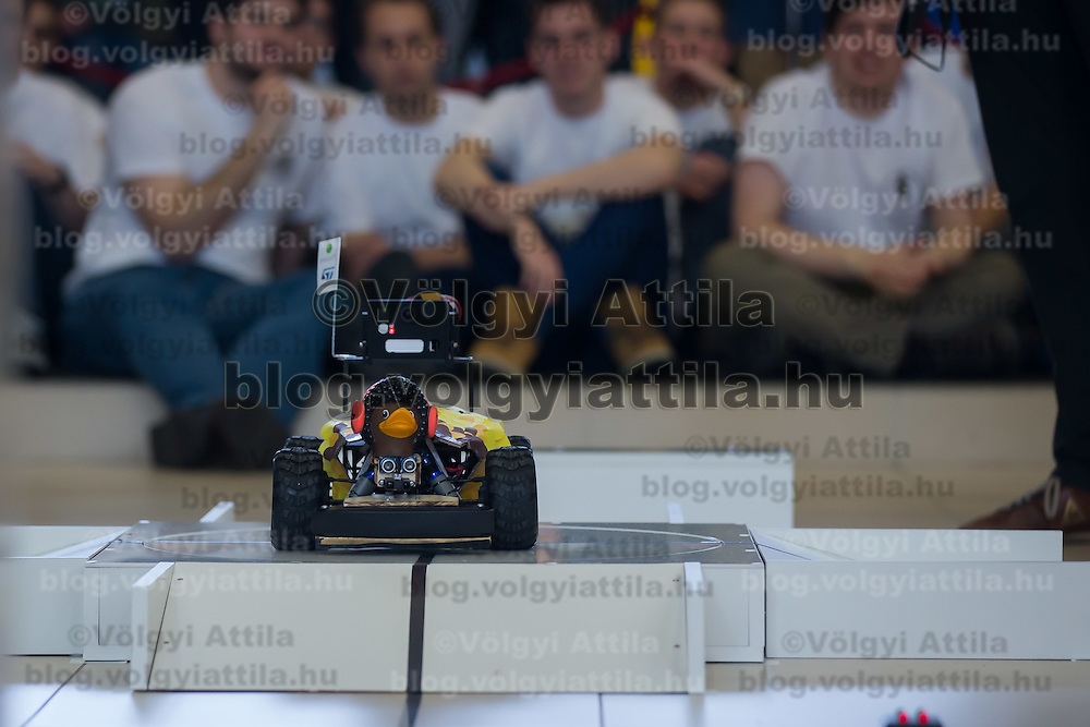 Viewers watch as robotic car tries to cross an obstacle during the RobonAut technical university race for self driving autonomous cars in Budapest, Hungary on January 10, 2015. ATTILA VOLGYI