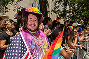 New York, NY - 25 June 2017. New York City Heritage of Pride March filled Fifth Avenue for hours with groups from the LGBT community and it's supporters. Spectators in front of the Marble Collegiate Church on Fifth Avenue.