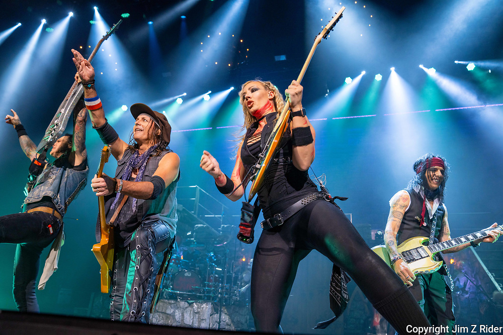 Base player CHUCK GARRIC, left, guitarist RYAN ROXIE, NITA STRAUSS, vocals and guitar, and TOMMY HENRIKSEN, rhythm and lead guitar, perform with Alice Cooper.  After nearly 19 months off stage, Rock and Roll legend Alice Cooper, 73, launched his fall 2021 tour at Ocean Casino Resort in Atlantic City, New Jersey.