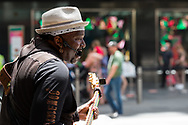 A busker is seen performing the Blues on Bourke Street Mall during Black Friday sales in the CBD.  As temperatures soured in Melbourne, locals flock to the city for Christmas bargains. Victoria saw its 29th day of no cases today but despite this the government show no signs of further lifting of restrictions. (Photo by Dave Hewison/Speed Media)