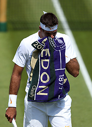 Juan Martin Del Potro during his match against Peter Gojowczyk on day two of the Wimbledon Championships at the All England Lawn Tennis and Croquet Club, Wimbledon.