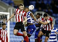 Jack O'Connell of Sheffield Utd flicks on a corner kick beyond Yakou Meite of Reading during the FA Cup match at the Madejski Stadium, Reading. Picture date: 3rd March 2020. Picture credit should read: Simon Bellis/Sportimage