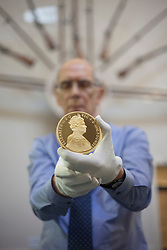 "© licensed to London News Pictures. London, UK 22/06/2012. New one-kilo gold, Diamond Jubilee coin, worth £60,000, goes on display as the Bank of England Museum opens a new free exhibition called ""Gold and the Bank of England"". Photo credit: Tolga Akmen/LNP"