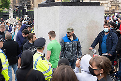 © Licensed to London News Pictures. 07/06/2020. London, UK. A group of un-identified men defend surround Sir Winston statue in Parliament Square against protesters for the group Black Lives Matter for the American George Floyd who died whilst being arrested by US policemen Derek Chauvin. His death has caused civil unrest in some US cities. Photo credit: Ray Tang/LNP